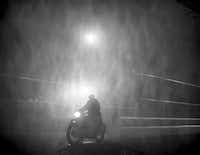 "A motorcyclist crosses Ludgate Circus in London on Dec. 6, 1952, during the deadly smog. (<p><span style=""font-size: 1em; background-color: transparent;"">Hachette Books</span></p>/<p><span style=""font-size: 1em; background-color: transparent;"">TopFoto-The Image Works</span></p><p><br></p>)"