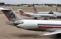 American Airlines and American Eagle planes sit on the tarmac Monday at St. Louis Lambert International Airport. American announced Monday that it ill close its pilots base in St. Louis next September 2018.(<p>St. Louis Post-Dispatch</p>/JB Forbes)