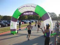 Runners cross the finish line at Running Over Depression, the 5K that Bradley Davis planned for his Eagle Scout project. Bradley lost two friends to suicide within a year.(Chip 2 Chip Race Timing)