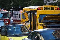 Authorities respond near a damaged school bus Tuesday, Oct. 31, 2017, in New York. A motorist drove onto a busy bicycle path near the World Trade Center memorial and struck several people on Tuesday police and witnesses said. (Mark Lennihan/AP)