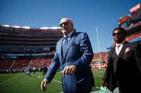 Dallas Cowboys owner Jerry Jones greets fans as the teams warm up before an NFL football game at Levi's Stadium in Santa Clara, Calif.(Smiley N. Pool/Staff Photographer)