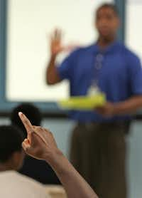 A juvenile offender raises his hand to ask a question during a group session, as seen during a tour of  the Dr. Jerome McNeil Jr. Detention Center inside the Henry Wade  Juvenile Justice Center, Dallas County's largest juvenile detention center, photographed on Thursday, August 17, 2017. (Louis DeLuca/The Dallas Morning News)(Louis DeLuca/Staff Photographer)
