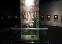 A piece of the Berlin Wall inscribed  with the word 'VISION' painted on it stands on display at the George Bush Presidential Library and Museum in College Station. (1997 File Photo/Staff)