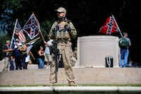 A Texas Liberty Coalition security person, who goes by the name Bulldog, stood guard at the This Is Texas Freedom Force protest over removal of the Robert E. Lee statue from the former Lee Park on Sept. 16, 2017.(Tom Fox/Staff Photographer)