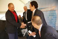 Hall of Fame catcher and former Texas Rangers player Ivan Rodriguez shakes hands with Alex Tisch, executive vice president of Loews Corporation, during a groundbreaking ceremony for Live! by Loews, a 302-room hotel under construction in Arlington.(Andy Jacobsohn/Staff Photographer)