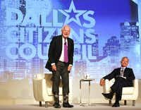 In this 2016 file photo, Bob Schieffer shows off his custom made boots with logos as CBS news anchor Scott Pelley laughs at the Dallas Citizens Council luncheon in Dallas.(Louis DeLuca/Staff Photographer)