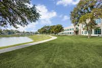 The four Lake Vista buildings surround a park and lake.(Shoot2Sell/Cushman & Wakefield)