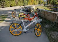 Two VBikes and a Spin bike are found along the Katy Trail on Wednesday.(Ron Baselice/Staff Photographer)