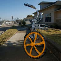 A Vbike was stranded along Zang Boulevard on Wednesday.(Ron Baselice/Staff Photographer)