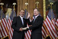 House Speaker John Boehner of Ohio participates in a ceremonial House swearing in ceremony for Rep. Lamar Smith, R-Texas, on Capitol Hill in Washington on Jan. 5, 2011. (Charles Dharapak/AP)
