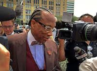 Dallas County Commissioner John Wiley Price walks out of the the Earle Cabell Federal Building in Dallas on April 28. Price was acquitted of federal bribery charges.(Jae S. Lee/Staff Photographer)