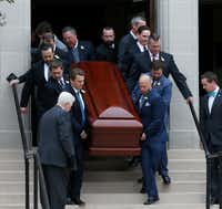 Pallbearers — including Dallas County Judge Clay Jenkins (right, second from top) — carried the casket of Brian Loncar down the front steps of the Munger Place Church following his funeral in Dallas on Dec. 9, 2016. The Dallas lawyer died two days after the funeral for his 16-year-old daughter Grace Loncar, who committed suicide.(Jae S. Lee/Staff Photographer)