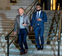 Dallas Cowboys star Ezekiel Elliott, right, exits federal court after a hearing Monday in New York.(Craig Ruttle/AP)