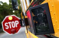 A Dallas County Schools bus with cameras mounted near the stop-arm. The cameras are intended to catch drivers who fail to stop. (File Photo/Staff )