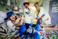 "Therapeutic medical clowns Tiffany Riley, a.k.a. ""Dr. Slappy"" (center), and Marcie Brannon, a.k.a. ""Dr. Dainty,""  entertain patient Marissa Leal, 10, in her hospital room at Cook Children's Medical Center in Fort Worth.(Smiley N. Pool/Staff Photographer)"