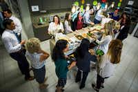 Northwestern Mutual employees fill their plates with a catered fajita lunch at their offices in Dallas.(Smiley N. Pool/Staff Photographer)