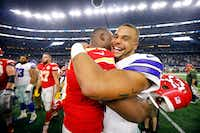 Dallas Cowboys quarterback Dak Prescott (4) hugs Kansas City Chiefs defensive end Chris Jones, a former teammate at Mississippi State, following the Cowboys' 28-17 win over the Kansas City Chiefs Sunday at AT&T Stadium in Arlington. (Tom Fox/Staff Photographer)