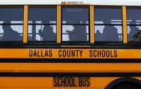 Buses drop students off at W.E. Greiner Exploratory Arts Academy in Dallas on Oct. 25, 2017. The fate of Dallas County Schools, the agency that provides bus service for Dallas ISD, rests in Dallas County voters' hands Tuesday.(Staff Photographer/Nathan Hunsinger)