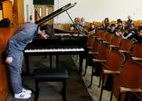 Cliburn Silver Medalist Kenny Broberg bows after he performed to students and teachers at South Hills Elementary School in Fort Worth, Texas (David Woo/The Dallas Morning News)