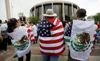 "In June, protesters outside the federal courthouse in San Antonio took part in a rally to oppose the Texas ""sanctuary cities"" bill that aligns with the president's tougher stance on illegal immigration.(Eric Gay/The Associated Press)"