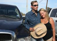 Johnnie Langendorff poses for a photo with his mother Heather Langendorff by the truck he used during a high speed pursuit of the Sutherland Springs Baptist Church gunman after the killing rampage at the church in Sutherlnd Springs, Texas.(Louis DeLuca/Staff Photographer)