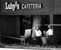 Workers remove debris from the scene of the Luby's massacre in 1991.(Erich Schlegel)