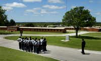 At the Gainesville State School, a group of male inmates prepared to march back to their dorm following lunch, in 2007.(Staff photographer/FILE 2007)