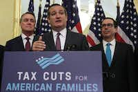 "U.S. Sen. Ted Cruz (R-TX) (2nd L) speaks as Sen. David Perdue (R-GA, left) and Secretary of the Treasury Steven Mnuchin listen during a news conference on tax reform. Senate Republicans held a news conference to discuss ""the need for tax reform and the impact it will have on American families, small businesses and the economy."" (Alex Wong/Getty Images)"