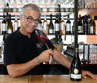 Daniele Puleo, chef-owner of CiboDivino Marketplace in Dallas, swirls a glass of Lambrusco.(David Woo/Staff Photographer)