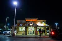 This Whataburger at the corner of North Dallas Parkway and Eldorado Parkway in Frisco was the focal point of the Whatabowl between Lone Star and Reedy high schools.(Ashley Landis/Staff Photographer)