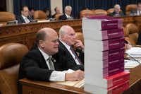 Seated behind a stack of IRS and tax volumes, Rep. Tom Reed, R-N.Y., left, joined by Rep. Mike Kelly, R-Pa., appeals to his Democratic opposition during debate on amendments to the House Republican tax reform plan,  in Washington, Wednesday, Nov. 8, 2017. (J. Scott Applewhite/AP)