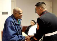 <p>Sam Johnson, a U.S. Army veteran who fought in World War II, shakes Marine Corps Staff Sgt. Eder Orozco's hand after receiving a pin and certificate at the Lennwood Nursing &amp; Rehab Veterans Day pinning ceremony.</p>(Benjamin Robinson/<p>Staff Photographer<br></p><p></p>)