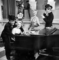 "Rosemary Clooney, at piano, with Bing Crosby (left) and Vera-Ellen and Danny Kaye in a scene from the 1954 movie version of ""White Christmas.""(Paramount Pictures)"