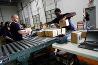 Frank Codispoti and Dupree Nobles prepare packages at ShipBob in Grapevine, November 2, 2017. The 3-year old company is expected to hire up to 40 people during the holiday season. (Lawrence Jenkins/Special Contributor)