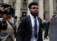 Dallas Cowboy Ezekiel Elliott walks out of federal court on Thursday in New York.(Julie Jacobson/AP)