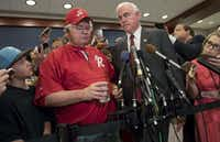 Rep. Joe Barton (left), R-Ennis and manager of the House Republican baseball team, and Rep. Pat Meehan, R-Pa., speak to the media after returning to the U.S. Capitol from a shooting incident during a baseball practice.(Saul Loeb/Agence France-Presse)