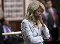 State Senator Wendy Davis reacts after a third point of order halts her filibuster during the final day of the legislative special session, as the Senate considers an abortion bill on Tuesday, June 25, 2013.  (Louis DeLuca/Dallas Morning News) 01012014xALDIA(Louis DeLuca/Staff Photographer)