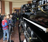 Third-graders from Frisco ISD's Tadlock Elementary look at the miniature steam locomotive as part of their tour of the Frisco Heritage Museum. (Jason Janik/Special Contributor)