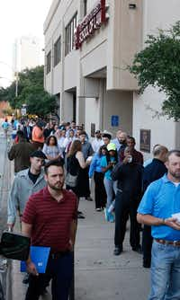 Hundreds of job candidates waited in line in August to apply for manufacturing positions for Lockheed Martin's F-35 fighter jet assembly plant in Fort Worth. Another hiring fair is set for Dec. 5.(David Woo/Staff Photographer)