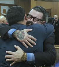 "Christopher ""Jake"" Carrizal (right) gets a hug following Friday's mistrial.(Tommy Witherspoon/Waco Tribune-Herald)"