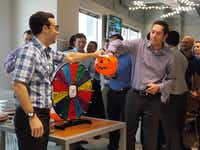Merit Energy sponsors an afternoon happy hour, where employees gather to support its  MS 150 Bike Team by participating in The Wheel of Misfortune. (Merit Energy)
