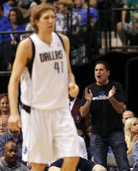 Dallas Mavericks owner Mark Cuban cheers on the team as Dallas Mavericks power forward Dirk Nowitzki (41) gets ready to defend.(Vernon Bryant/Staff Photographer)