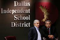 Dan Micciche (left), president of the DISD board of trustees, confers with DISD Superintendent Michael Hinojosa. (Andy Jacobsohn/Staff Photographer)