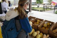 Jennifer Brown at the Coppell Farmers Market says the most important thing to her when it comes to shopping at the farmers market is pesticides and whether the food's grown ethically. (Alfonso Cevola/Special Contributor)
