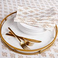 Large Gold Boteh Tablecloth, $89; Large Gold Boteh Napkins, set of four, $29;, Gilt and Marble Serving Tray, $99, wisteria(Wisteria)