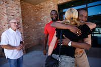 Exoneree Johnnie Lindsey hugs Dorothy Budd, author of <i>Tested: How Twelve Wrongly Imprisoned Men Held Onto Hope</i>, alongside fellow exonerees Steven Phillips (left) and Christopher Scott before a screening of <i>True Conviction</i>, a documentary film by Jamie Meltzer that features the three men and was released earlier this year. (Rose Baca/Staff Photographer)