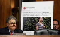 Senate Judiciary Committee member Al Franken, D-Minn., paused Wednesday as he questioned Don Willett and displayed a tweet made by Willett, during a committee hearing on Willett's nomination to the 5th Circuit Court of Appeals.(Carolyn Kaster/The Associated Press)