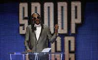 Celebrity inductee Snoop Dogg spoke during the WWE Hall of Fame event at Dallas' American Airlines Center in April 2016. (Jae S. Lee/Staff Photographer)