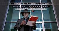 The Rev. Gerald Britt, vice president of external affairs with CitySquare, reads a statement during a rally with the Strong Schools Strong Dallas coalition at the DISD headquarters in Dallas. (2017 File Photo/Jae S. Lee)