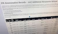 Part of a web page showing the page from the National Archives showing a listing of records released on Thursday, Oct. 26, 2017, in Washington, relating to the assassination of President John F. Kennedy.(Jon Elswick/AP)